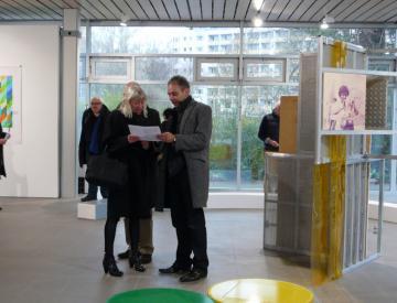 11 expo - Besucher in der Ausstellung